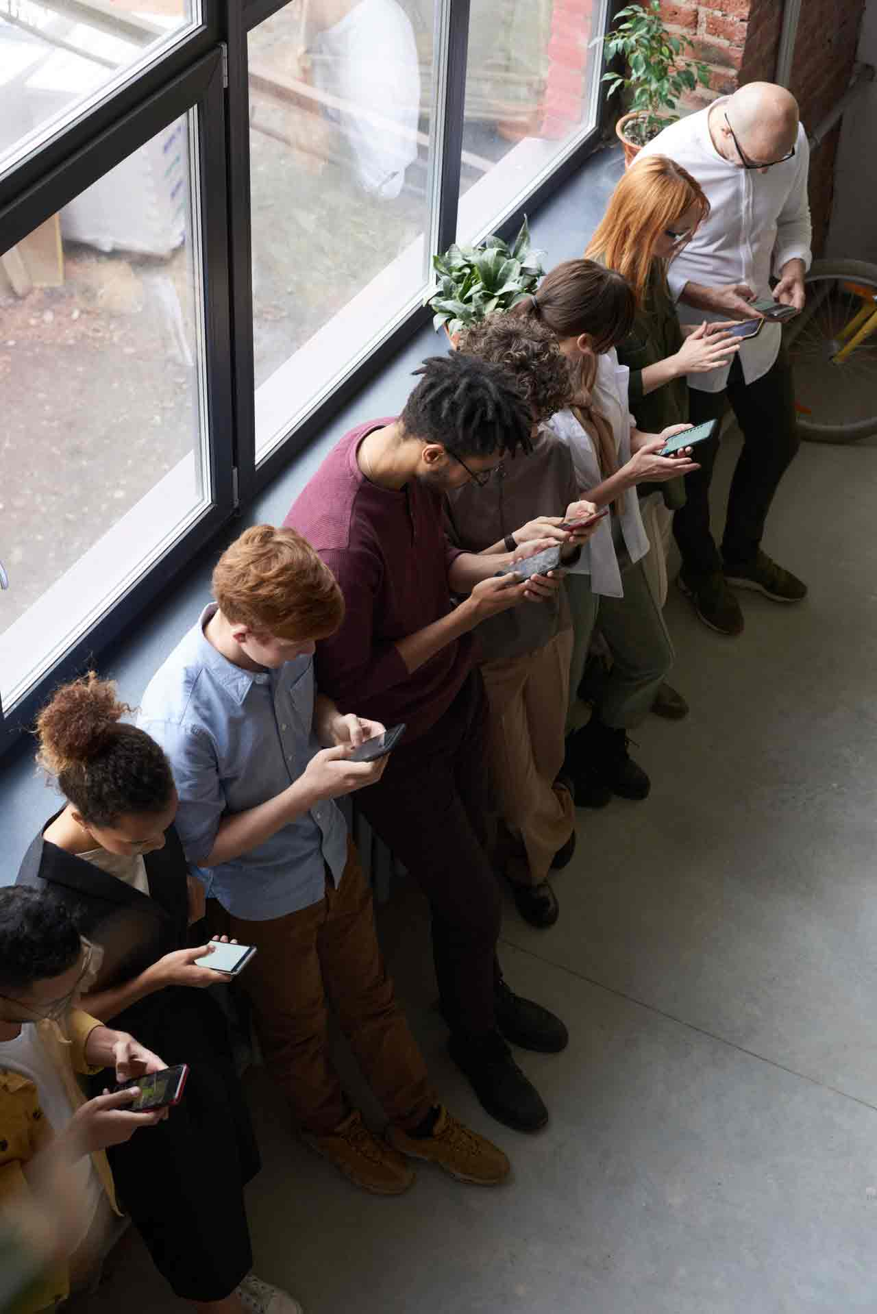people-holding-their-phones-3184435