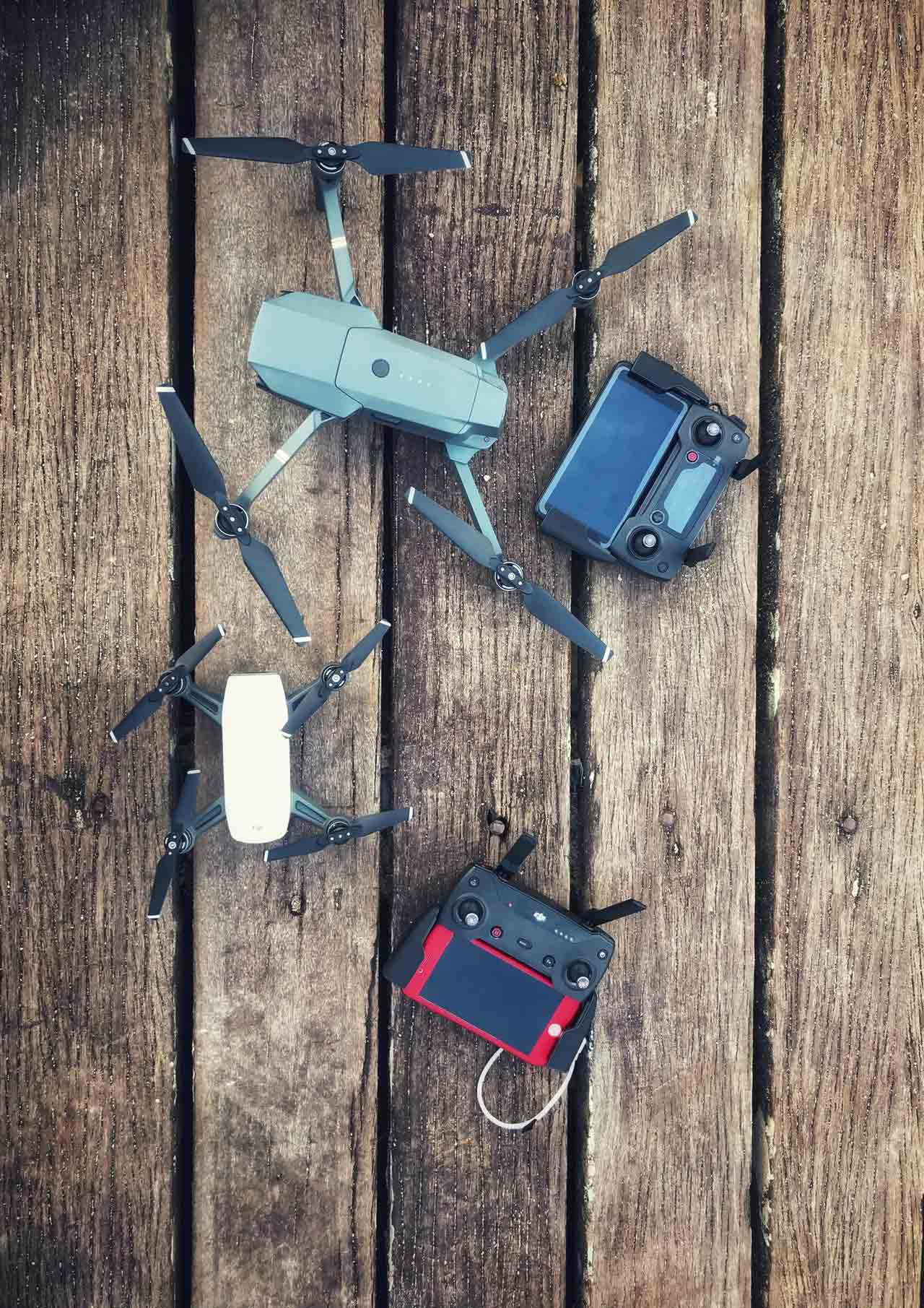 two-assorted-quadcopter-drones-with-controllers-810493